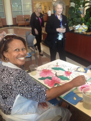 Left, BRG volunteers Viney Samuel and Virginia Alexander enjoy a special activity with Arts in Medicine specialists, including Patti Bailey, pictured.